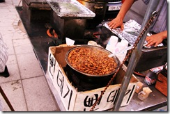 seoul.cooking worms in  the street